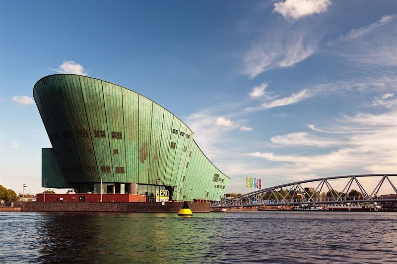 Nemo Science Museum Amsterdam Architecture Built Structure Sky Travel Destinations Travel Building Exterior City Arts Culture And Entertainment Day Cloud - Sky Bridge - Man Made Structure Outdoors Water No People Harbor Modern Cityscape City Life Waterfront