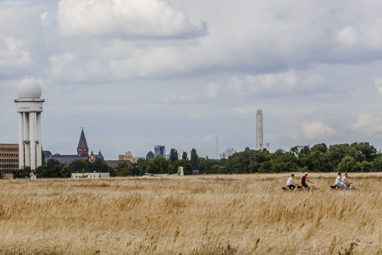 City City Life Cityscape Cityscapes Cloud Cloud - Sky Cloudy Day Field Grass Landscape Leisure Activity Lifestyles Medium Group Of People Mixed Age Range Nature Nature Outdoors Sky Tempelhof Tempelhofer Feld Tourism Tourist Travel Destinations Vacations
