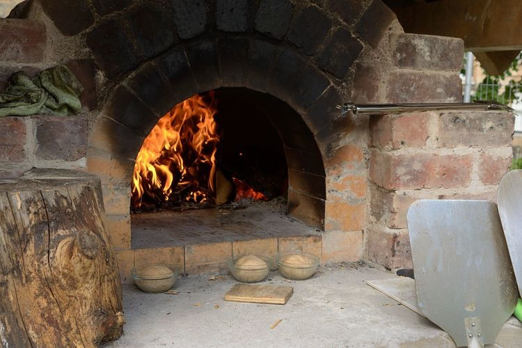 Wood Fired oven Burning Fire Fire - Natural Phenomenon No People Flame Arch Architecture Fireplace Wood Burning Stove Nature Heat - Temperature Built Structure Solid Day Wood - Material Wood Log Indoors  Firewood Oven Bread Oven Wood Fired Oven