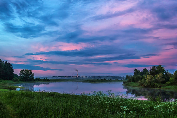 Evening sky Beauty In Nature Cloud - Sky Evening Light Extreme Weather Grass Lake Landscape Multi Colored Nature Night Sky Sunset Travel Water