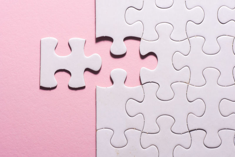 puzzle Puzzle  Jigsaw Piece Solution Jigsaw Puzzle Pink Color Leisure Games Connection Pattern Indoors  White Color Blank No People Relaxation Full Frame Incomplete Close-up Backgrounds Intelligence Paper Still Life Design Complexity