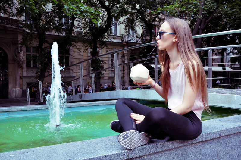 Instagram Life Coconut Fountain Beautiful Woman Chill Drinking FreeTime Instagram Leisure Activity Lifestyles Long Hair One Person Sitting Young Women