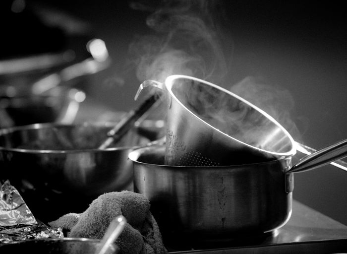 Kitchen Utensil Kitchen Utensil Smoke - Physical Structure Food And Drink Food Preparation  Household Equipment Pan Stove Heat - Temperature Steam Indoors  Kitchen No People Cooking Pan Appliance Close-up Domestic Room Preparing Food Saucepan Steel Black & White Hot