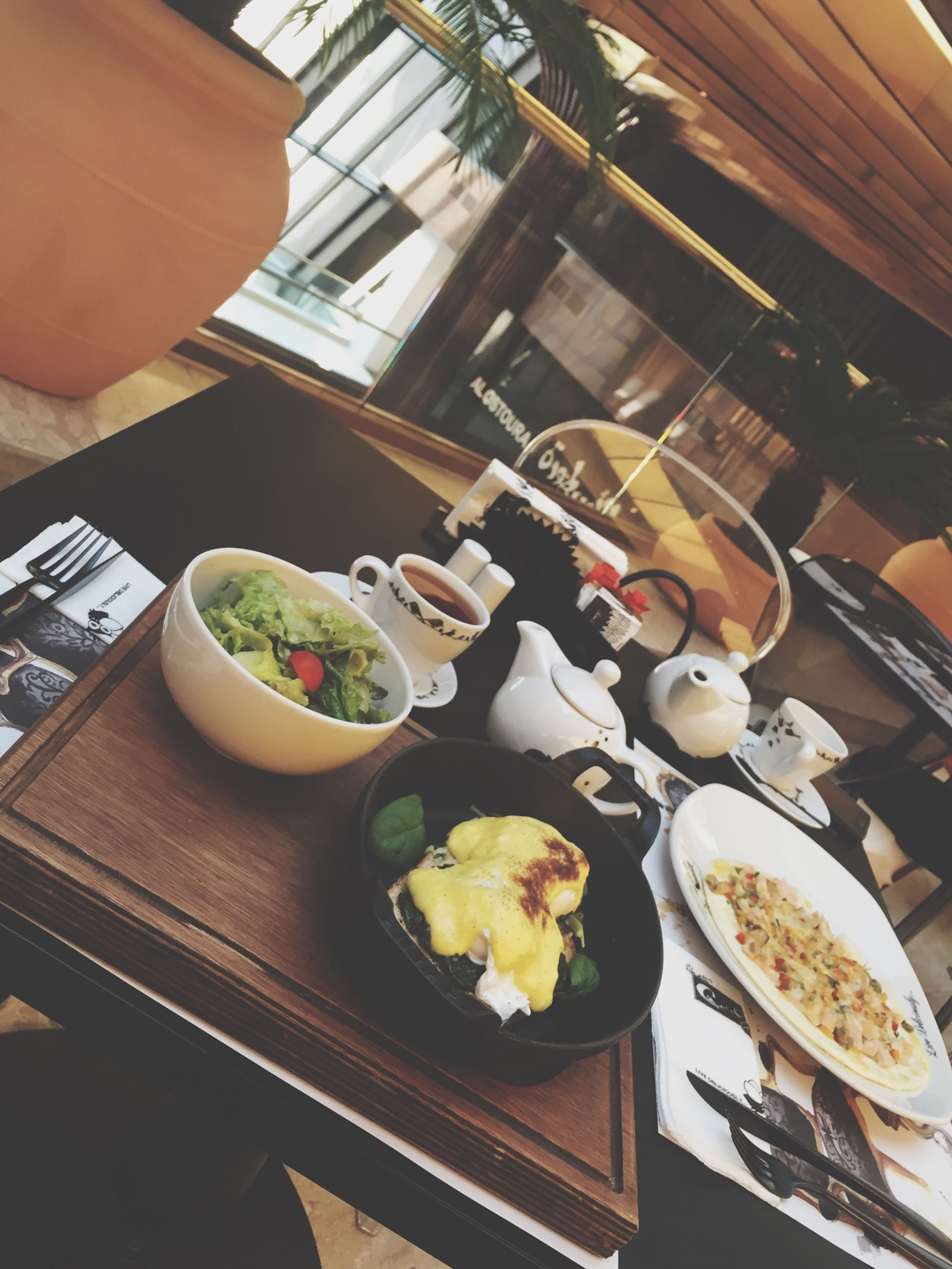 indoors, table, food and drink, freshness, high angle view, still life, plate, food, bowl, no people, home interior, variation, flower, wood - material, chair, restaurant, ready-to-eat, glass - material, fork, close-up