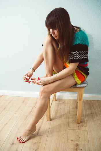 Woman Painting Toenails At Home