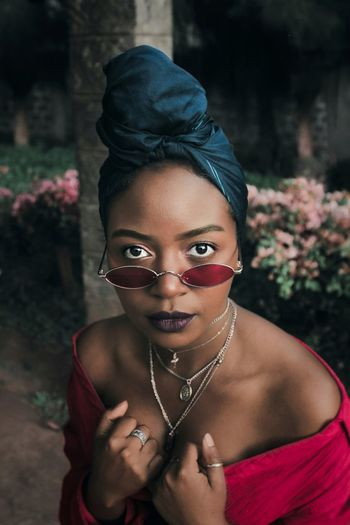 Africa Photography EyeEm Best Shots Portrait Of A Woman Sunglasses Close-up Beauty Portrait Portrait Young Women Looking At Camera Beauty Women Cheerful Human Face Beautiful Woman Females Necklace Earring  Eye Make-up