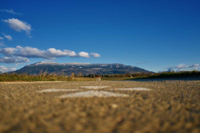 Road into blue sky