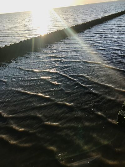When the sun Not only breaks in the water LenseFlare Water Sunlight Sea Rippled Wave Nature No People Beauty In Nature Scenics Waterfront