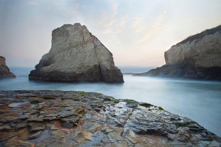Shark Fin Cove Rock in greater Santa Cruz, California. Water Rock - Object Scenics Majestic Vacations Travel Destinations Cliff