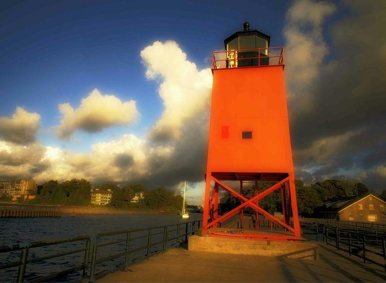Scenic, Charlevoix Lake Michigan On The Beach Beach Sailboat Lighthouse Sunset View. Michigan Pure Michigan Red Mirrorless Fine Art Photography