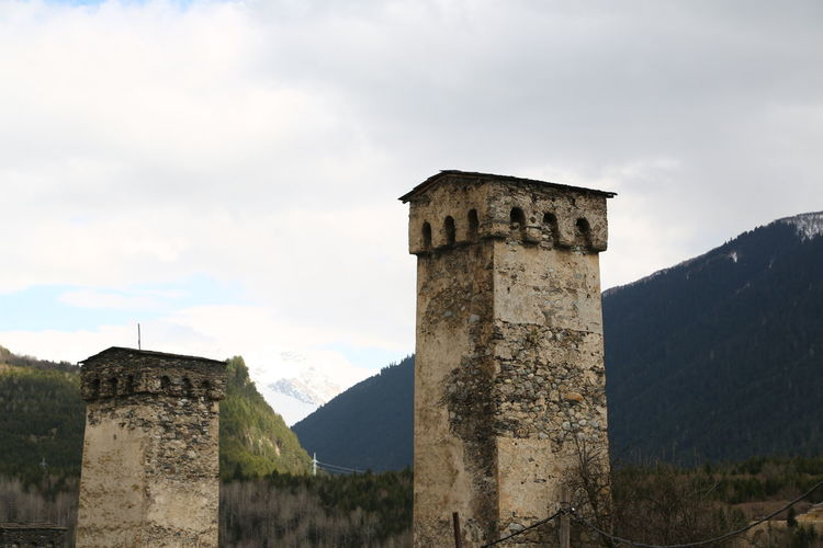 Sky Architecture Built Structure The Past History Nature Cloud - Sky Mountain No People Day Building Exterior Ancient Travel Destinations Old Building Outdoors Travel Solid Old Ruin Stone Material Stone Wall Ancient Civilization Georgia Mestia/town In Svaneti/Georgia