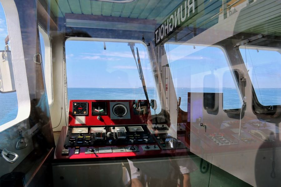 On the way to Amrum seen at the horizon. Auf dem Weg nach Amrum. Man kann es am Horizont durch die Fensterscheiben sehen. Ferryboat Reflections Multiple Reflections Windows Shadow Hello World On The Way Taking Photos North Sea Enjoying Life Relaxing Sommerwetter Outdoor Photography Blue Sky Germany🇩🇪 Tranquility