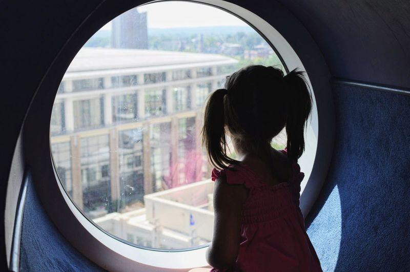 Looking out at the city. Window One Young Woman Only Child Adapted To The City Windows On The World Circles Shadows & Lights Urban Geometry Pig Tails Light And Shadow Up High The City City Life Curious Pink Dress Reflections In The Glass Windows Hartford Ct  Connecticut