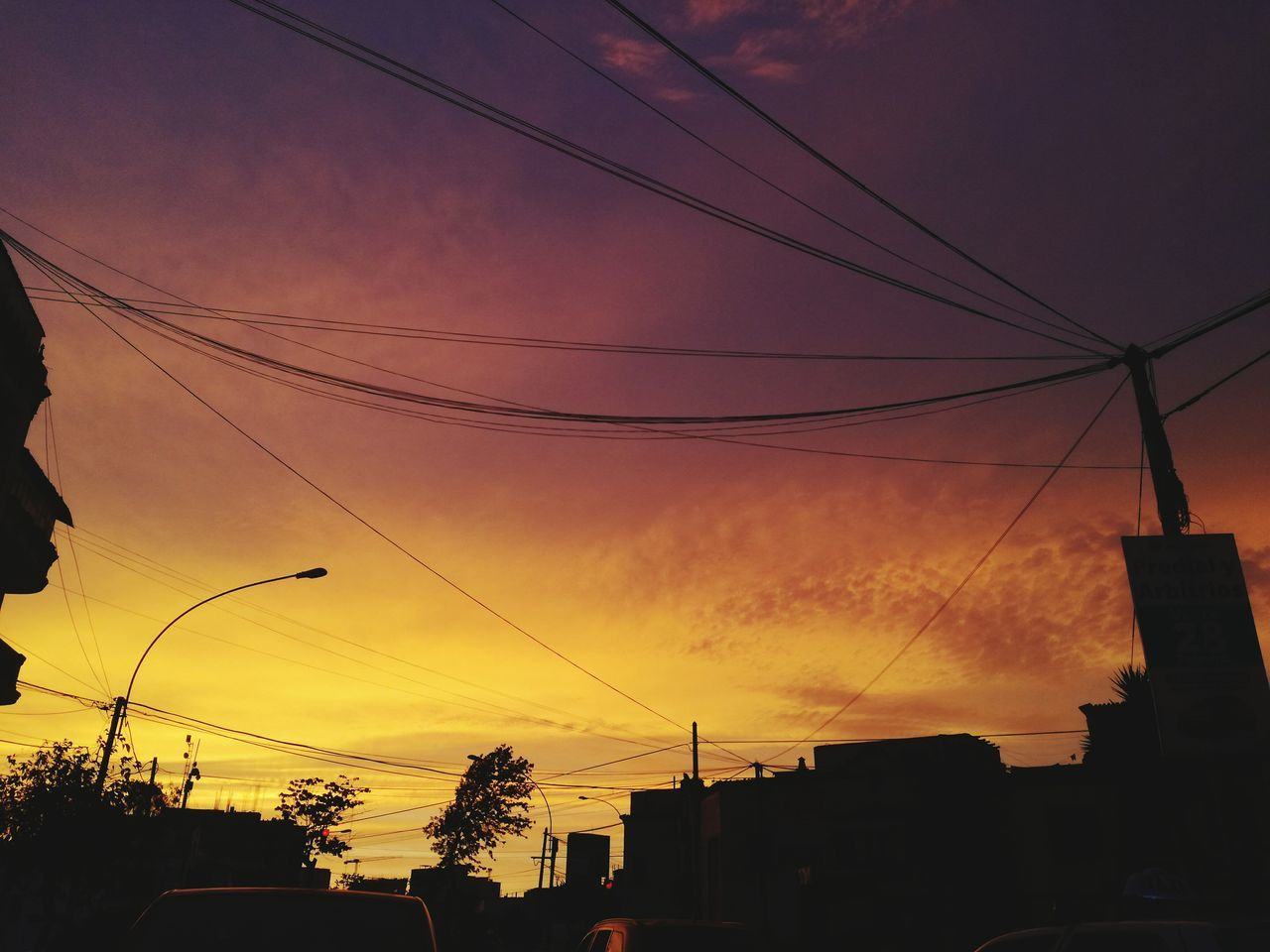 sunset, silhouette, cable, sky, architecture, building exterior, power line, built structure, no people, city, nature, outdoors, beauty in nature, tree, telephone line