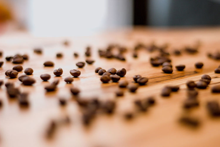 Selective Focus Indoors  Large Group Of Objects Food And Drink Food Table Close-up No People Wood - Material Roasted Coffee Bean Freshness Still Life Abundance Day Brown Wellbeing Black Color Seed Surface Level