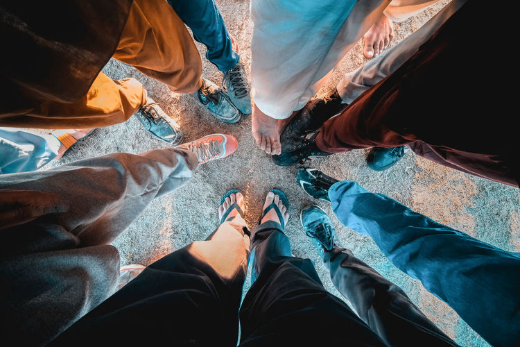 Togetherness Human Leg Group Of People Low Section Personal Perspective Standing Friendship People Leisure Activity Shoe Jeans Human Foot Lifestyles Rural Pakistan Soccer Team  Field Teamwork Agreement Casual Clothing Real People High Angle View Bhoa Hassan, Punjab Pakistan