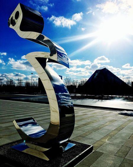 Tanavoli Heech Statue Art ArtWork Museum Agha Khan Outdoors Toronto Sunny Pyramid Artist Sunlight Sky Clouds Reflection Backwards  Behind Stainless Steel  Shiny Canada Neighborhood Map