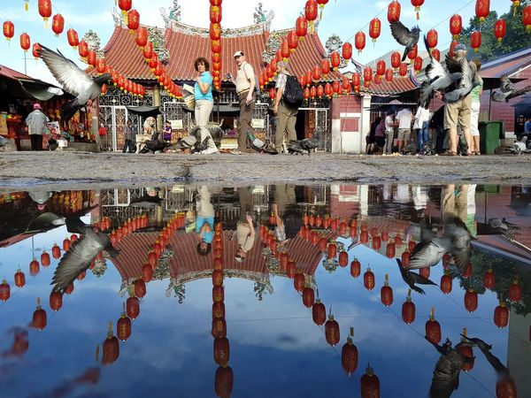 Guan Yin Temple. 100th years history , the older temple in Georgetown, Penang, Malaysia Temple #building #sky #mirror #street #streetphotography #georgetown #penang Herritage# #penang #samsungphotography #mobilephotography #samsunggalaxyS8plus #photography #culture Reflection Water Day Sky Outdoors No People EyeEmNewHere Business Stories An Eye For Travel Go Higher