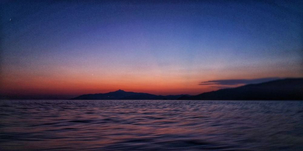 First day o the boat Boat Sailboat Sailing EyeEm Nature Lover Potography Summertime EyeEm Selects Sea Sunset Mountain Blue Water Astronomy Sky Horizon Over Water Landscape Romantic Sky Moon Crescent Moonlight Dramatic Sky Astrology