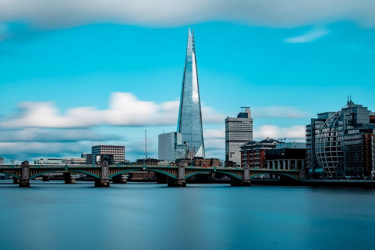 London Architecture Built Structure Bridge - Man Made Structure Connection Sky City Building Exterior Travel Destinations Skyscraper Tower Travel Waterfront River No People Modern Low Angle View Transportation Cloud - Sky Day Outdoors London