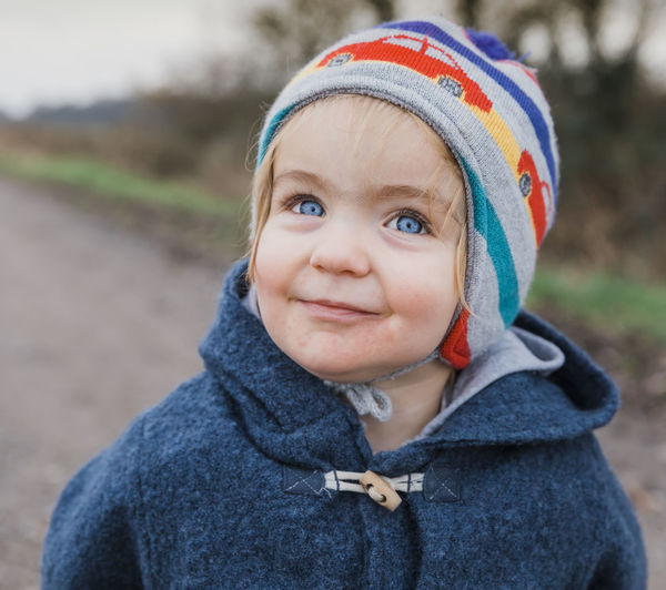 Portrait of happy toddler girl with blue eyes – Kempen, Germany Baby Babyhood Babygirl Blond Hair Blue Eyes Blond Hair And Blue Eyes Toggle Button Carefree Casual Clothing Caucasian Cheerful Coat Confidence  Contemplation Cute Duffle Coat Positive Emotion Enjoying Life Enjoyment Excitement Face Faces Of EyeEm Human Face Facial Expression Field Footpath Germany Girl Girls Females Gravel Road Dirt Road Happy Happiness Head And Shoulders Jacket Joy Looking Up Nature People Road Country Road Smile Toddler  Toddlerlife Watching Anticipation Wool Healthy Lifestyle Fun Portrait Headshot Clothing Childhood Child One Person Front View Focus On Foreground Innocence Looking At Camera Day Warm Clothing Close-up Winter Smiling Hood Knit Hat Hood - Clothing Outdoors The Portraitist - 2019 EyeEm Awards