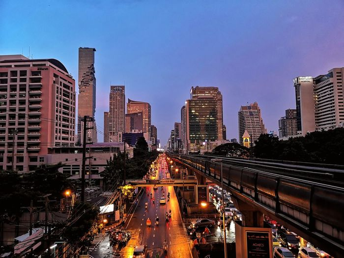 Illuminated city street at dusk