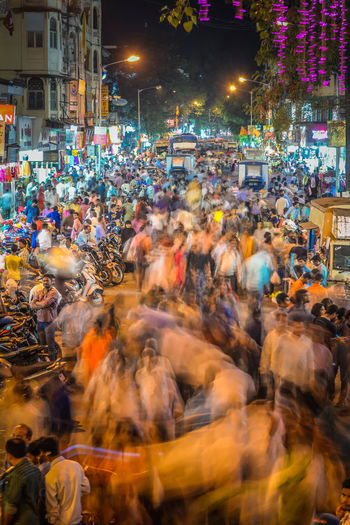 Rush Hour Blurred Motion Building Exterior Busy Street City Crowd Dadar Market Illuminated Large Group Of People Market Marketplace Men Motion Night Outdoors People Real People Slow Shutter Street Women
