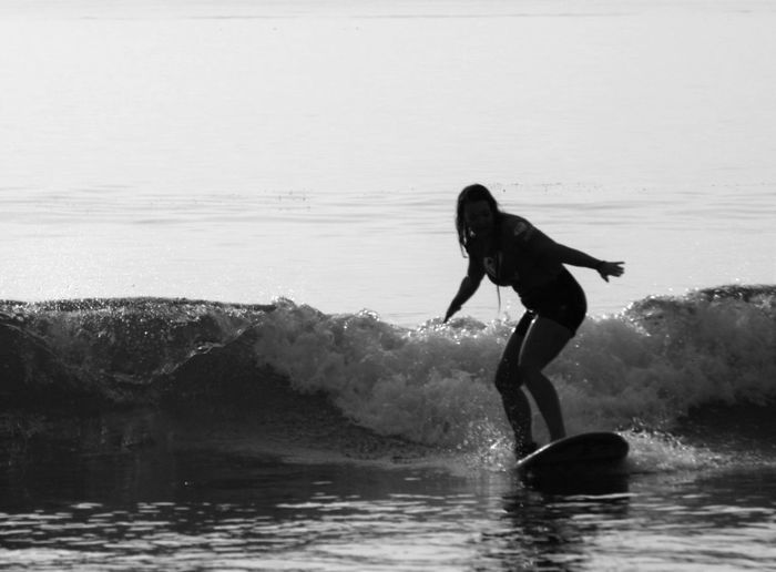 Woman surfing on sea