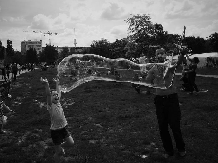 Children playing on landscape against sky