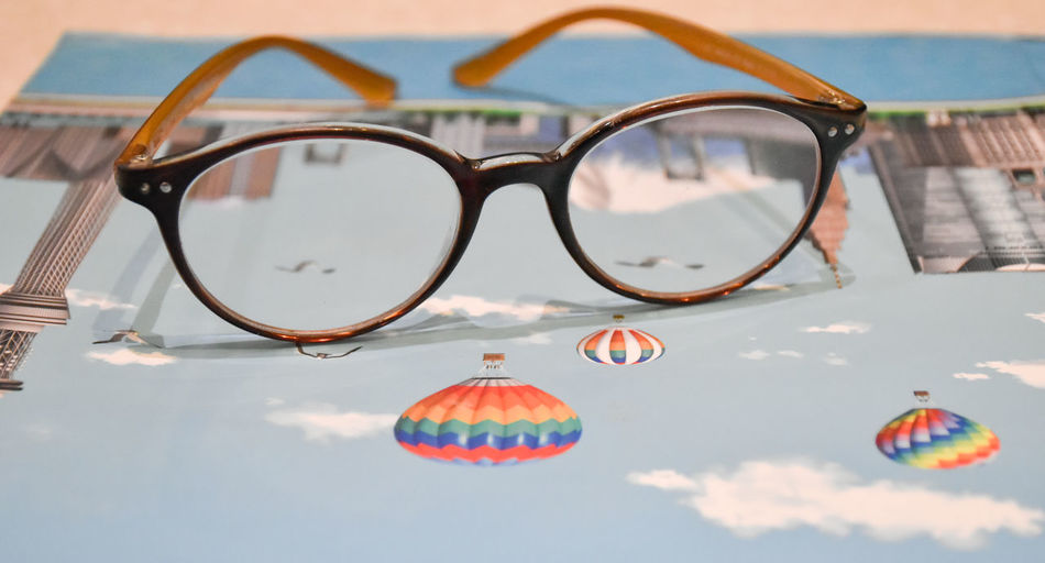 Close-up of sunglasses against sky