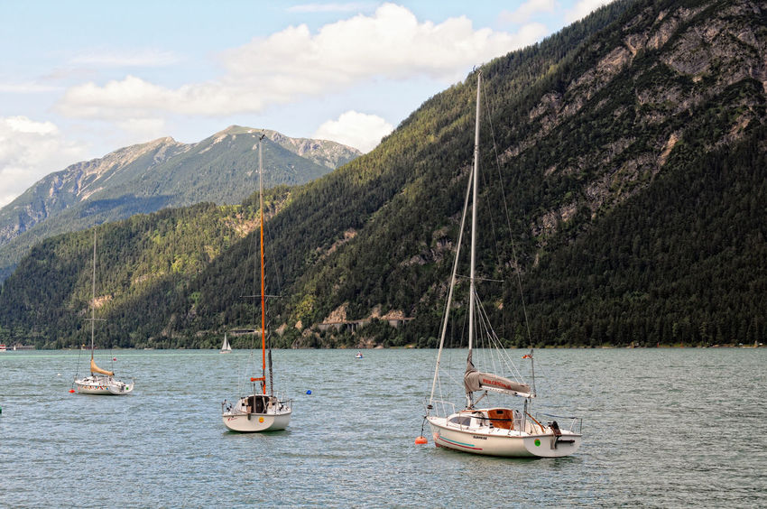 Boast and ships on Achensee in Austria. Achensee Cloud - Sky Day Karwendel Karwendelgebirge Lake Mountain Nature Nautical Vessel Outdoors Pertisau Pertisau Am Achensee Sailing Sailing Ship Sky Tirol  Tourist Boat Trip Water