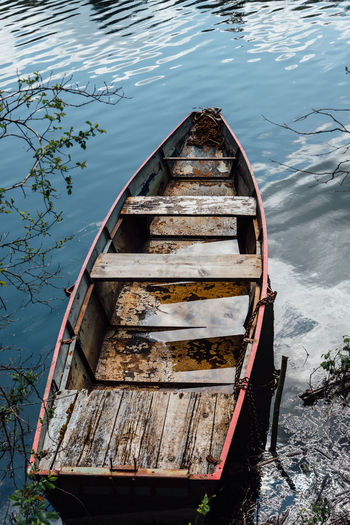 Abandoned Beauty In Nature Boat Damaged Day High Angle View Lake Mode Of Transport Nature Nautical Vessel No People Old Outdoors Ruined Rusty Small Boat Transportation Water Wood - Material