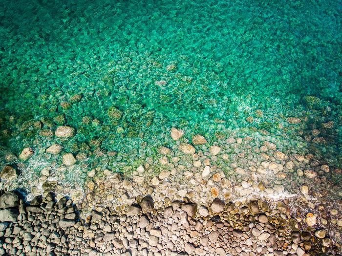High angle view of pebbles on sea shore