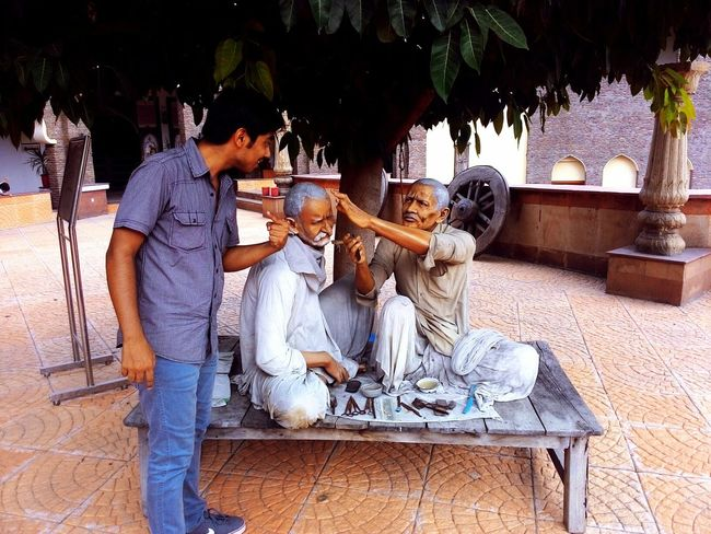 """Would you cut my hair too?"". Thats what I'm trying to say to the sculptured man. This is a photo from museum of State History at Kurukshetra Univeraity. People Portrait People Working Having Fun People Photography Taking Photos Check This Out Haircut Time Haircut"