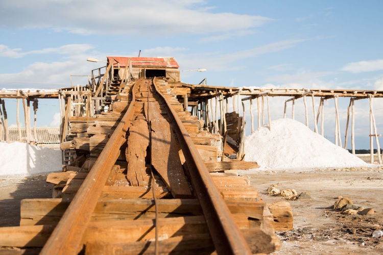 Bani Dominican Republic Railroad Track Architecture Beauty In Nature Built Structure Cloud - Sky Day Nature No People Outdoors Playa Salinas Produccion Sal Salt Production Sky Structure Sunlight Water Wood - Material