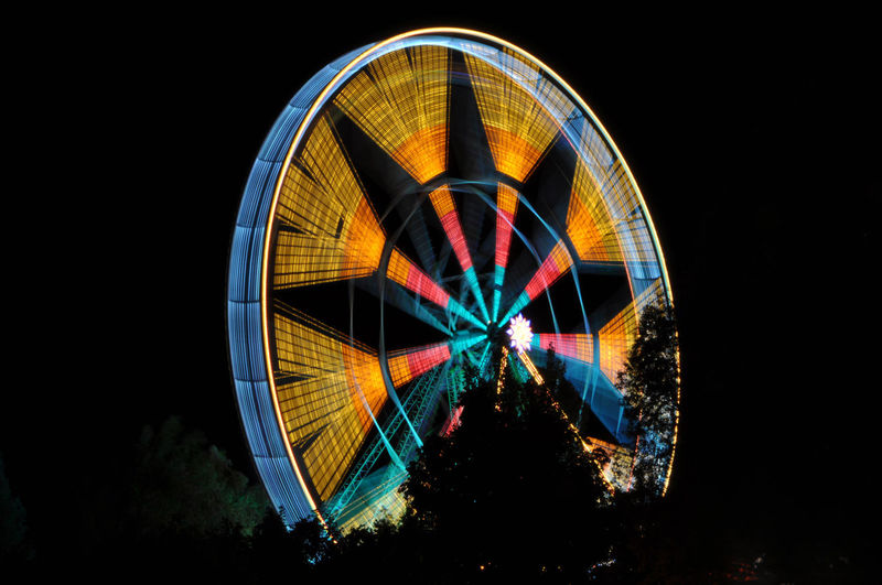 Ferris Wheel in Long Exposure. Amusement Park Amusement Park Ride Architecture Arts Culture And Entertainment Carnival Dark Excitement Ferris Wheel Glowing Illuminated Leisure Activity Light Long Exposure Motion Multi Colored Nature Night Nightlife No People Outdoors Sky Spinning