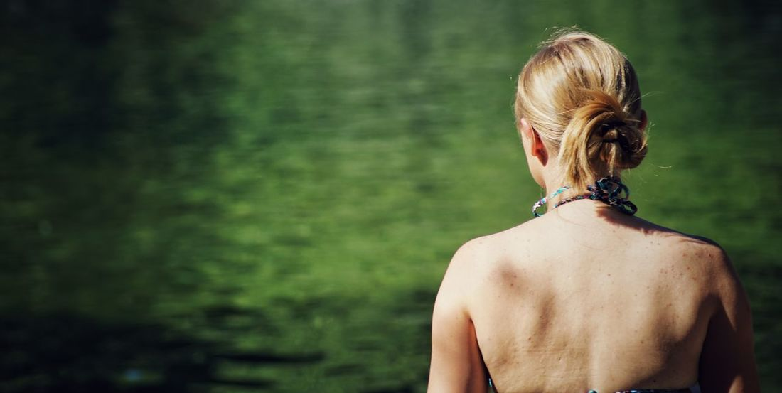 A girl Alone Beauty Water Rear View Human Back Real People Hair Bun One Person Back Women Day Outdoors Adult