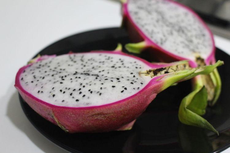 Close-Up Of Halved Pitaya On Plate