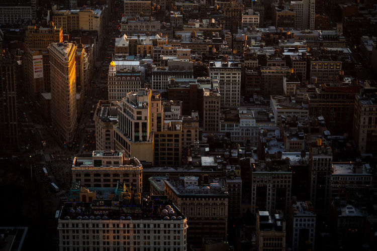 Illuminated flatiron building from the top of the empire state in new york