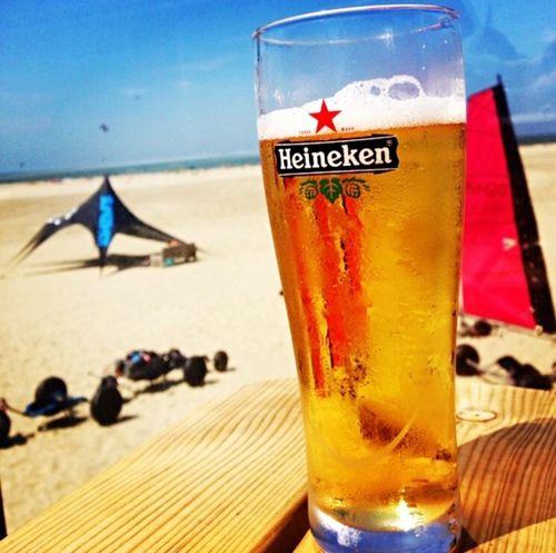 Heineken Beer, Nordwijk Beach Gold Nordwijk Heineken Drink Beach Refreshment Food And Drink Alcohol Sea Table Beer Sand Outdoors Vacations Water Sky Horizon Over Water first eyeem photo