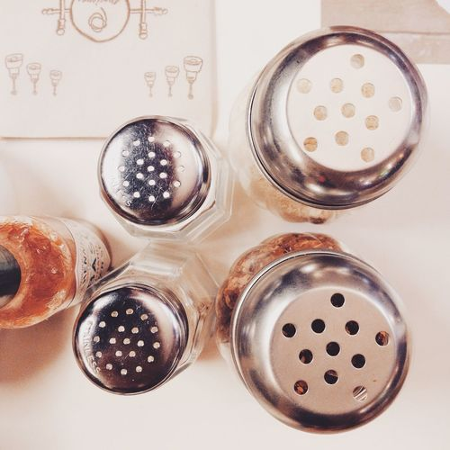Directly Above Shot Of Salt And Pepper Shakers On Table