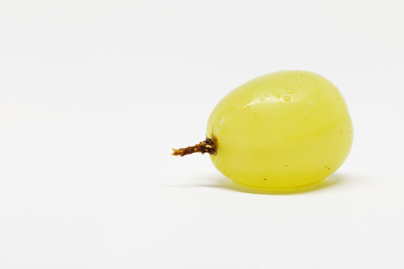 High angle view of yellow lemon on white background