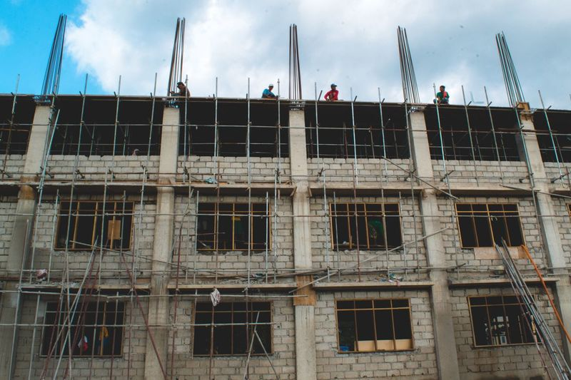 Architecture Low Angle View Building Exterior Built Structure Window Sky Construction Day Outdoors Real People Men Occupation Window Washer Eyeem Philippines EyeemPhotos EyeEm Best Shots