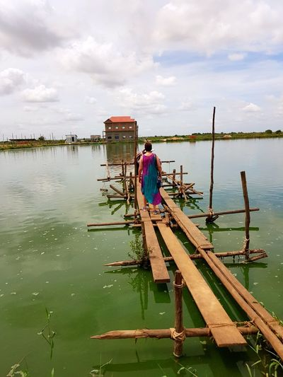 Fishfarm, cambodia An Eye For Travel Water Occupation Full Length Adult Nautical Vessel Adults Only Men Working Sky River People Day Outdoors Fisherman Two People Nature