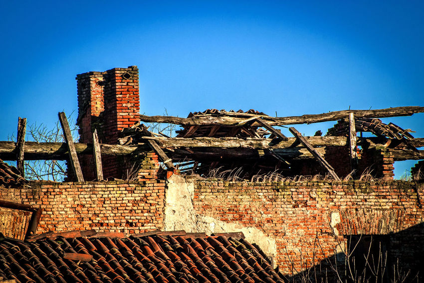 Rural roofs - Parco Agricolo Sud Milano, Italy Architecture Bad Condition Blue Bricks Built Structure Chimey Chimneys Clear Sky Countryside Damaged Day Deterioration Exterior Farmstead No People Obsolete Old Outdoors Roof Roofs Ruined Rural Sky