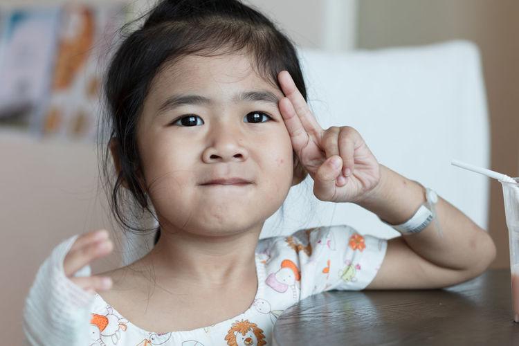 Cute girl gesturing at hospital