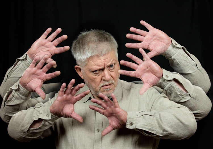 Cropped image of man hand against black background