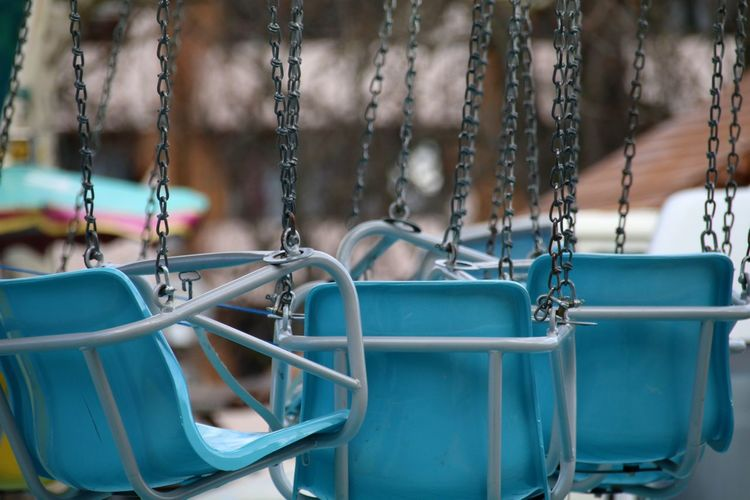 Close-up of swing at park