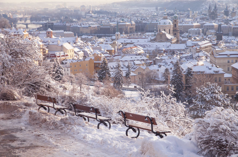 High angle view of townscape and snow in city