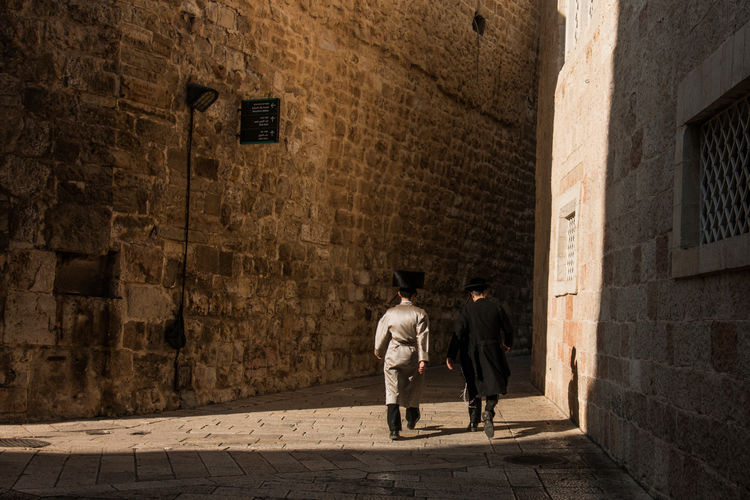 Israel Jewish Ortodox Jewish Into Light Future Peace Tradition Architecture Full Length Rear View Walking Street People Men Built Structure City Wall - Building Feature Adult Wall Alley Footpath on the move Two People Shadow Outdoors Motion Real People EyeEmNewHere Human Connection